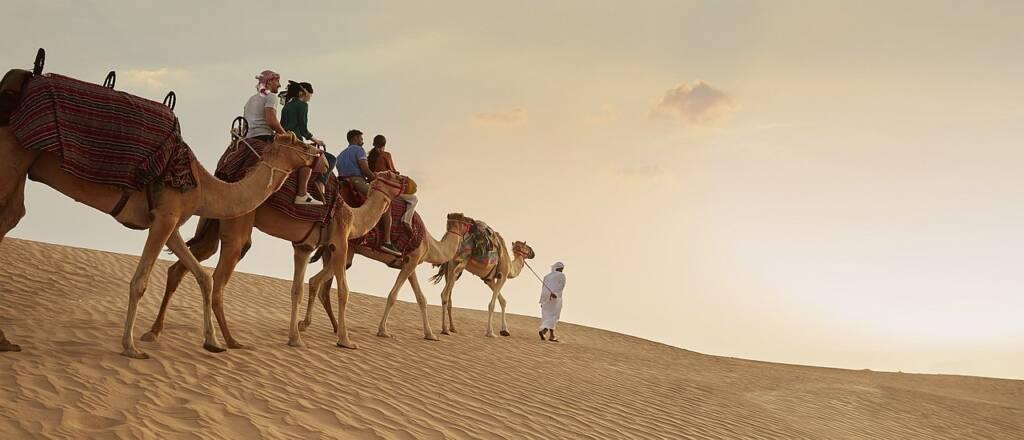 Worldwide travel: camel trek in the desert of Dubai